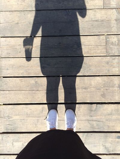 Black Casual Clothing Close-up Coffee Coffee Time Day Dress Footwear Girl Human Foot Leisure Activity Lifestyles Low Section Outdoors Part Of Person Personal Perspective Shadow Standing Unrecognizable Person Vans White Wood - Material Wooden