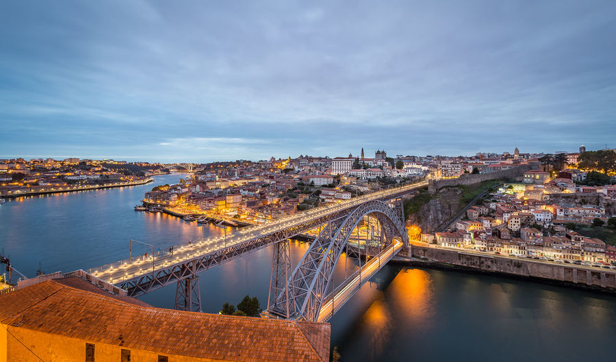 High Angle View Of Dom Luis I Bridge Over River By Illuminated Buildings In City