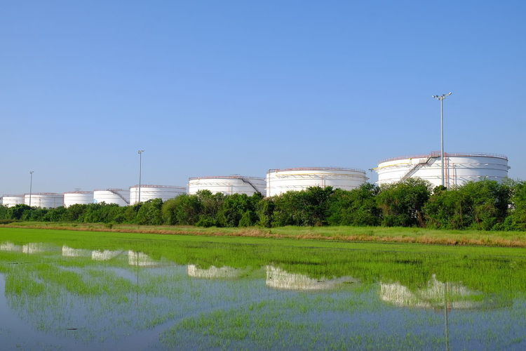 Oil depot Water Agriculture Rural Scene Flood Business Finance And Industry Sky Grass