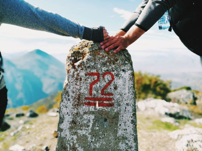 Couples Holding Hands On Kilometer Stone