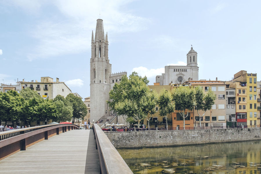 Catedral De Girona Cathedral Girona Cathedral Houses River View Riverside Architecture Bridge - Man Made Structure Building Exterior Built Structure City Colorful Colorful City Colorful Houses Day History No People Outdoors Religion River Spirituality Travel Destinations Tree Water
