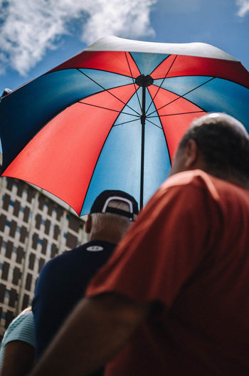 Be safe Real People One Person Protection Umbrella Rear View Men Leisure Activity Security Lifestyles Sky Day Nature Casual Clothing Holding Adult Outdoors Low Angle View Human Body Part Rain Street Photography EyeEm Best Shots EyeEm Selects The Art Of Street Photography