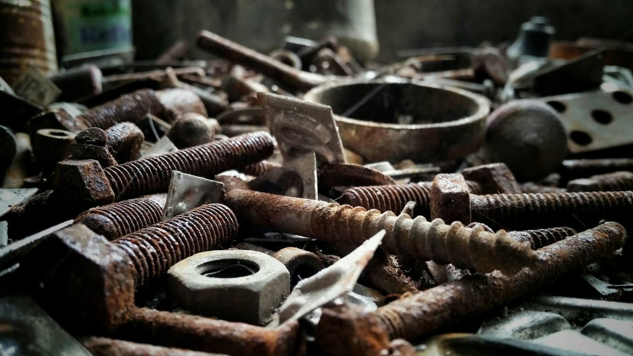 Rusty Nuts And Bolts On Floor