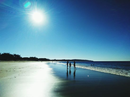 Beach Water Reflection Sun Shore Sea Wet Blue Clear Sky Tranquil Scene Scenics Sand Sunlight Vacations Beauty In Nature Tranquility Nature Bright Summer Calm People Around  People Walking On The Beach People Tourist Shadow And Light @ Agnes Water.
