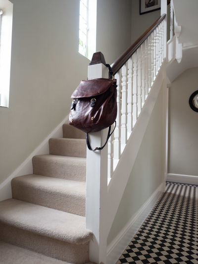 Bag Staircase Steps And Staircases Architecture Indoors  Home Interior No People Railing Day Window Built Structure White Color Building Wall - Building Feature Absence Animal House Domestic Room Low Angle View