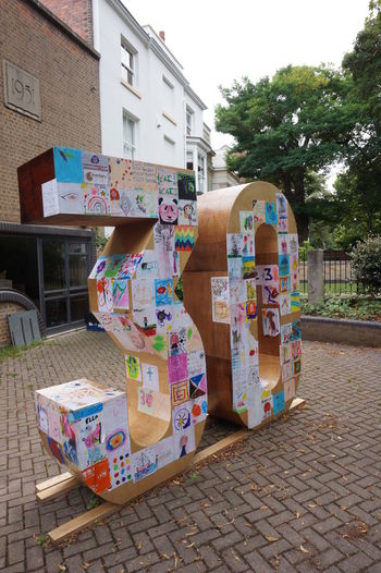 0 3 30 6296 Architecture Art Art And Craft ArtWork Building Exterior Built Structure City Covered Creativity Drawings In Front Of TakeoverContrast Large Group Of Objects Messy Modern Art Outdoors Papered Street Text Tree Unusual