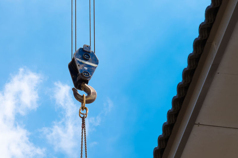 Crane Hook lifting for construction on blue sky,steel hook and chain, copy space Equipment Sky Built Structure No People Hook Tool Vehicle Machine Heavy Crane Chain Construction Lift Blue Iron Closeup Site Rope Industry Backgrounds