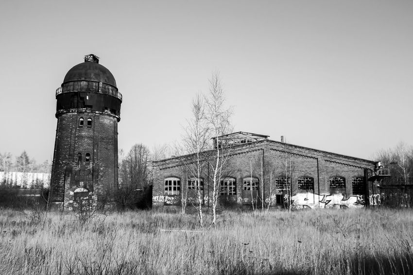 Leipzig Abandoned Architecture Bahnbetriebswerk Building Exterior Built Structure Clear Sky Day Grass Lost Places In Leipzig Lostplaces Nature No People Outdoors Run-down Sky