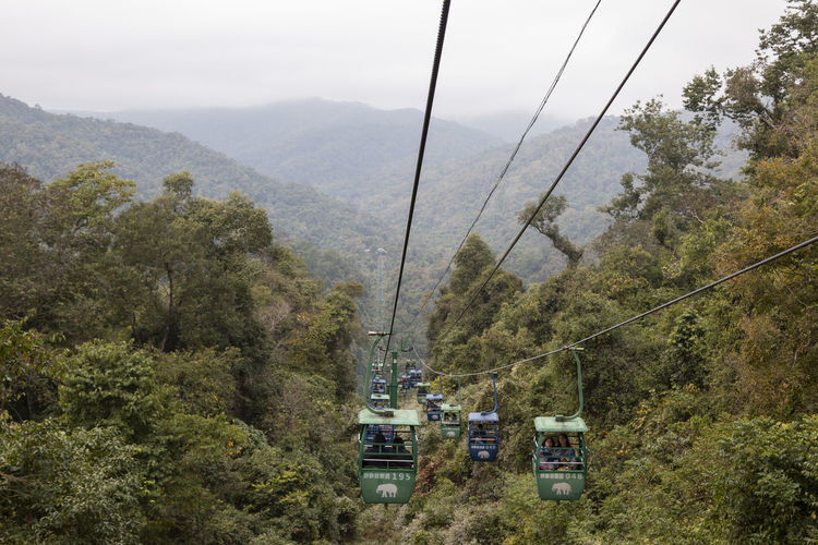 Overhead cable cars over mountains