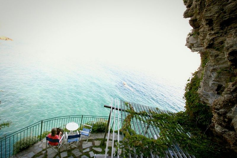 A lady relaxing in Italy watching the oceanCapturing Freedom Enjoying Life Enjoying The View Nature Photography Color Photography From My Point Of View Cinque Terre Vacation Vacation Time Reading Time Alone Healthy Healthy Lifestyle Woman Peoplephotography Eye4photography  Italy