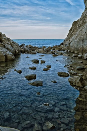 Water Nature Sea Rock - Object No People Beauty In Nature Sky Scenics Outdoors Tranquility Tranquil Scene Beach Day Sunset Nature Light And Shadow Nikond3300 Freshness Close-up High Angle View Seabed Sea And Sky Seascape Rock Rock Formation