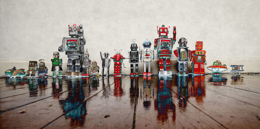 a line of old retro robot toys No People Creativity Human Representation Flooring High Angle View Toy Large Group Of Objects Robot Toys Teamwork Line Art Toned Solarized Hi! Hello Wooden Floor Panoramic Toys Toy Robots Play Technology Vintage Old-fashioned Fun Toned Image Reflection