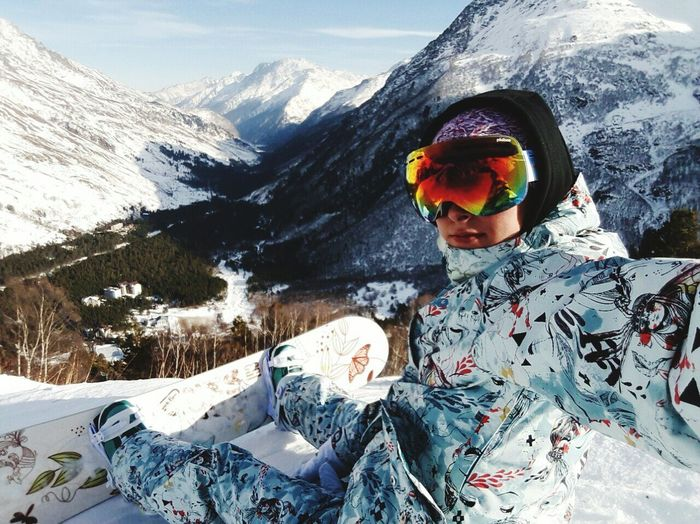 Mountain One Person Mountain Range Snow Adults Only Snowboarding Sport Leisure Activity Travel Destinations One Woman Only Outdoors Portrait Adult Vacations Winter People Ski Holiday Adventure Ski-wear Warm Clothing