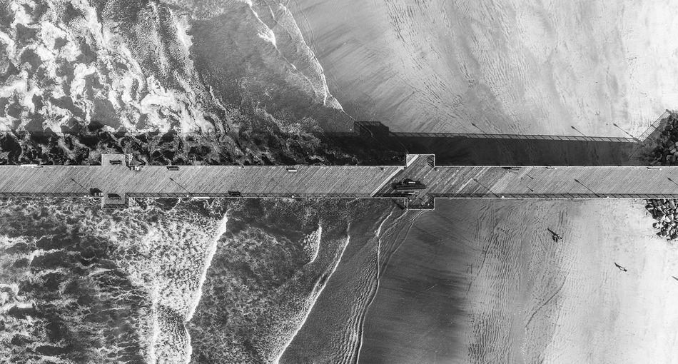 High angle view of dam by sea