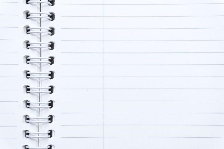 Full frame shot of open blank spiral notebook