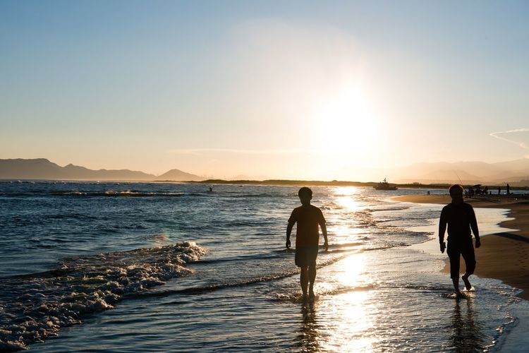 Water Sea Full Length Sunset Beach Paddleboarding Sports Team Sportsman Togetherness Men Surfer Ankle Deep In Water Wave Wading Freshwater Bird Flamingo Aquatic Sport Shallow Windsurfing Surfboard Surfing Kiteboarding Surf Water Sport Hiker Friend