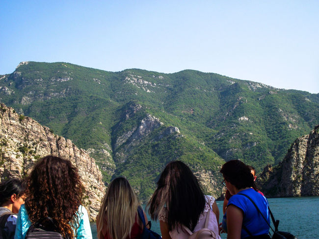 Friendship Women Men Togetherness Mountain Tree Group Of People Young Women Sky Lush - Description Mixed Age Range Lush Foliage Visiting Green Countryside Rocky Mountains Stream Valley Large Group Of People Mountain Range