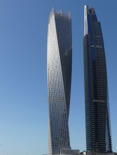 Two Skyscrapers at the Marina, Dubai, United Arab Emirates 2019 Dubai UAE 2019 Marina Blue Sky Low Angle View Twisted Towers Sunlight And Shade No People Modern Architecture Modern Design Glass And Steel Structure Tower Blocks Urban Skyline Tall - High City Building Facades Architecture Full Frame Composition Outdoor Photography Building Exterior Tourist Destination Apartments