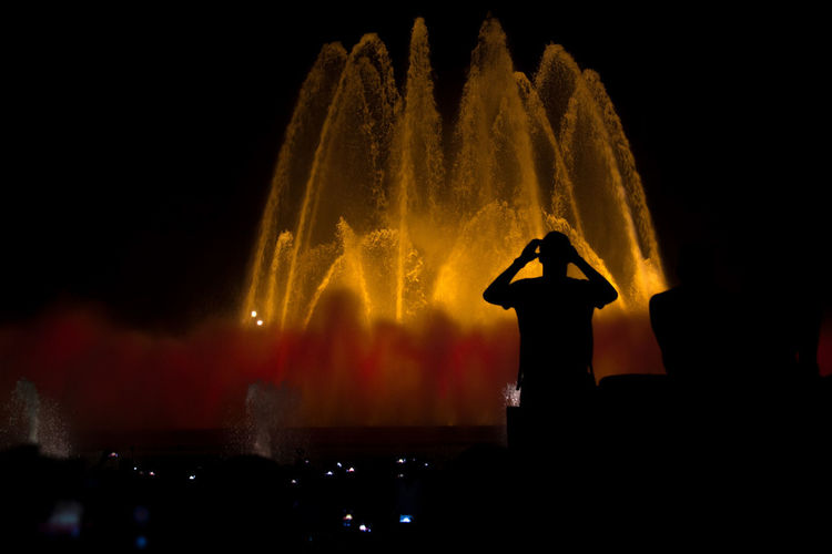 Magic Fountain, Barcelona Arts Culture And Entertainment Barcelona Event Fountain Illuminated Magic Fountain Music Night Outdoors Performance Real People Silhouette SPAIN Stage - Performance Space Travel Destinations Vacation Water