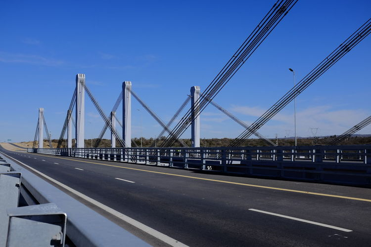 puente colgante Architecture Blue Bridge Bridge - Man Made Structure Built Structure City Clear Sky Connection Day Long Mode Of Transportation Nature No People Outdoors Road Sign Sky Street Suspension Bridge Symbol Transportation