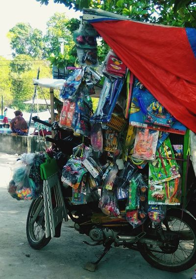 toy store Toys Sales Selling On The Street Selling Stuff Selling Toys Motorcycle Land Vehicle Tree Multi Colored Sky Vehicle Motor Scooter Urban Scene