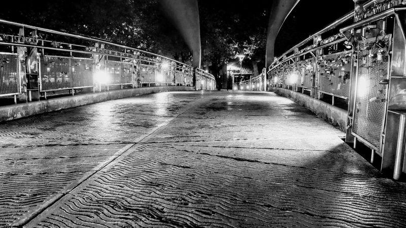 padlock bridge Photowalktheworld Padlock Black And White Nightphotography Illuminated Water Bridge - Man Made Structure City Architecture Built Structure Suspension Bridge