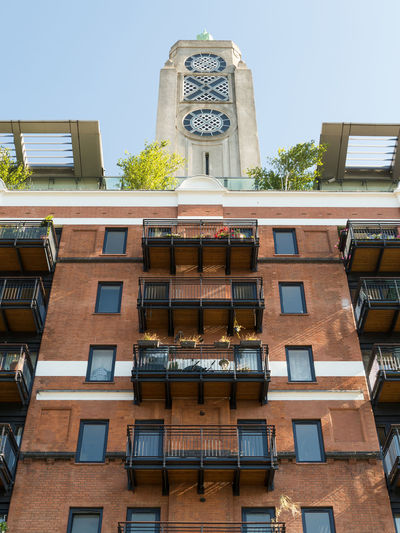 The OXO Tower in London Architecture Apartment Architecture Balcony Building Building Exterior Built Structure City Clear Sky Day Glass - Material In A Row Low Angle View No People Outdoors Oxo Oxo Tower Plant Residential District Sky Tower Tree Window
