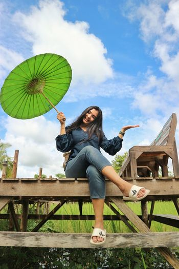 women happyness😁 Moments Of Happiness Young Women Full Length Beauty Sitting Women Beautiful People Beautiful Woman Cheerful Portrait Females Umbrella Under Footbridge Bridge - Man Made Structure Sun Hat Rope Bridge Covered Bridge Shelter
