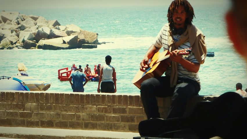 Sea Playing Music Skill  Horizon Over Water Musical Instrument People Beach Water Only Men Outdoors Adult Day Performance Young Adult Beachphotography Beach Promenade Musician Gitarist Streetphotography Street Art Namibia Africa Swakopmund First Eyeem Photo