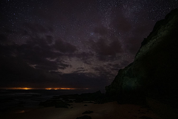 Scenic view of sea against sky at night