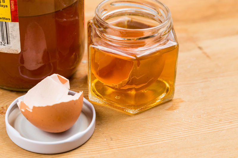 Egg shell soak in apple cider vinegar as home remedy to relieve itchy skin Itchy Apple Cider Vinegar Close-up Eggshell Food Food And Drink Glass - Material Home Remedies No People Relieve Wellbeing Wood - Material
