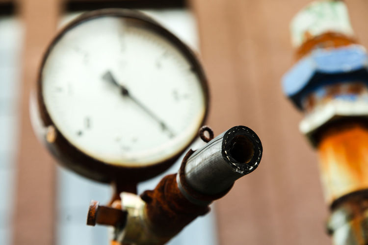 Close-up of pressure gauge in factory
