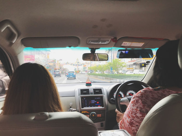 Rear view of woman traveling in car