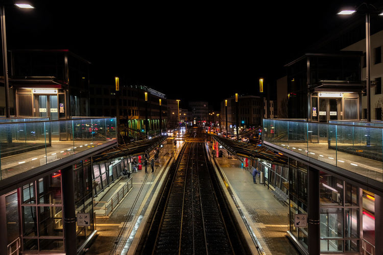 Railroad station in city at night
