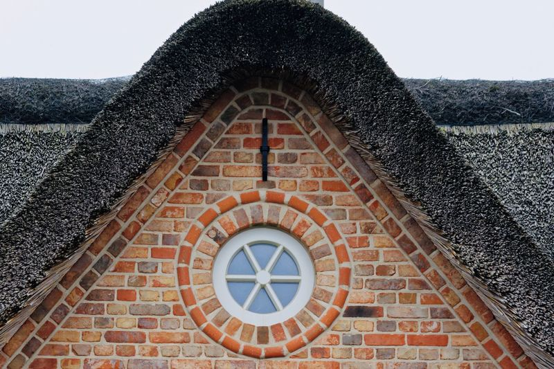 Wonderful thatched roof Eye4photography  Eyeemphotography EyeEm Best Shots Thatchedroof Thatched Roof EyeEm Selects Architecture Built Structure Day Building Exterior No People Sky Brick Brick Wall Low Angle View Window Pattern