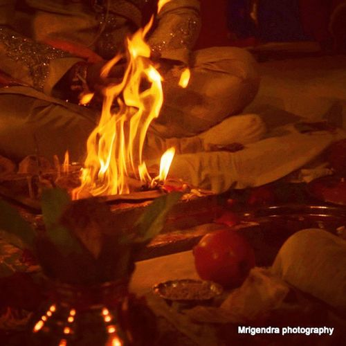 "In Hinduism, Yagna (Sanskrit: यज्ञ; IAST: yajña, also transliterated yagya, Yagna or yadnya) or yagam (Tamil: யாகம்), is a ritual of offerings accompanied by chanting of Vedic mantras (also ""worship, prayer, praise, offering and oblation, sacrifice"" according to Monier-Williams) derived from the practice in Vedic times. Yajna is an ancient ritual of offering and sublimating the havana sámagri (herbal preparations) in the fire. The sublime meaning of the word yajna is derived from the Sanskrit verb yaj, which has a three-fold meaning of worship of deities (devapujana), unity (sangatikarana) and charity (dána).[1] An essential element is the ritual fire – the divine Agni – into which oblations are poured, as everything that is offered into the fire is believed to reach God. The Sanskrit word Yagna is linguistically (but not functionally) related to Zoroastrianism's (Avestan language) Yasna. Unlike Vedic yajna, Zoroastrian Yasna is the name of a specific religious service, not a class of rituals, and (also unlike Vedic Yagna ) that service has ""to do with water rather than fire"".Wedding Friendswedding Ritual D3300 Ujjain Meghdootresort Mrigendraphotography Hinduism Clickforlike Bondforlife"