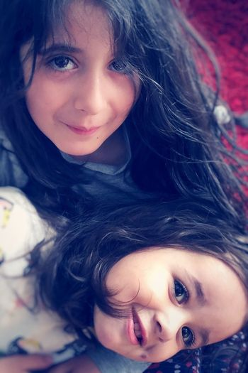 Sisters ❤ Sisters Looking At Camera Portrait Childhood Girls Real People Two People Long Hair Togetherness Love Child Happiness Headshot Smiling Close-up Bonding Day People Relaxing Moments Genuine Smile Genuinesmile Genuine Moment Genuinehappiness Relaxing