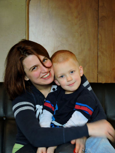 Real People Love Portrait Happiness Boys Mother And Son Day Cute Smiling Childhood Son Bonding Indoors  Togetherness Adult Close-up Affectionate Lifestyles Embracing Looking At Camera Young Adult Mother And Son Love Human Connection