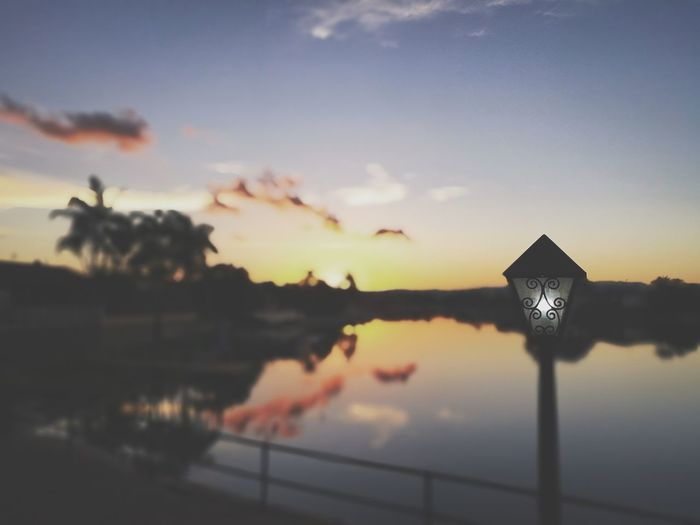 Sky Sunset Water Reflection Cloud - Sky Nature No People Beauty In Nature Silhouette Scenics - Nature Tranquility Outdoors Street Street Light Lake Tranquil Scene Lighting Equipment Plant Built Structure