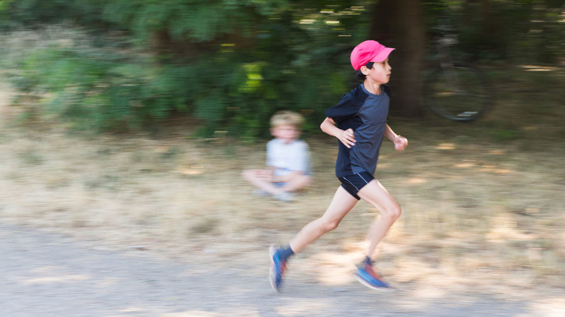 The Runner 11 Year Old Blurred HAPA Kids Hat Blurred Motion Caucasian Ethnicity Child Childhood Chinese Ethnicity Day Full Length Hapa Leisure Activity Lifestyles Motion Nature Outdoors People Real People Running Speed Tree Two People The Portraitist - 2018 EyeEm Awards