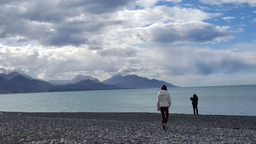 Two People Mountain Rear View Cloud - Sky Mountain Range Beauty In Nature Travel Destinations Beach Kaikoura New Zealand