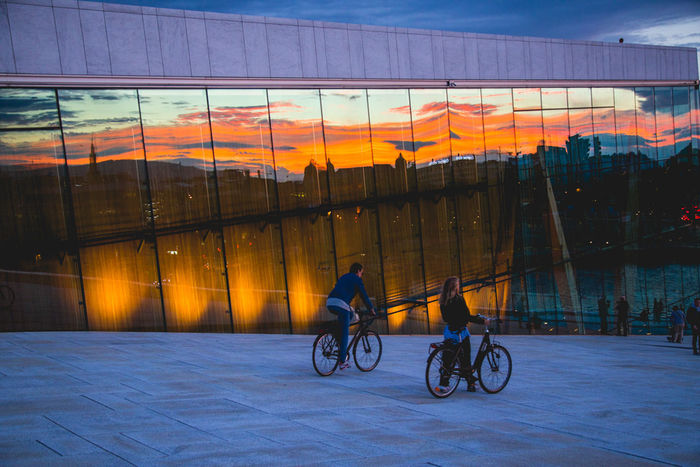 Opéra Architecture Bicycle Building Exterior Built Structure City Lifestyles Men Outdoors People Real People Riding Sky Sunset Women EyeEmNewHere
