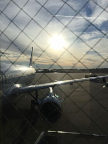 Sunny with a chance of cold Infentic Graphix Infenticgraphix Nano Nanoisincontrol #infgraphix Nanoisincontrol Sun Lens Flare Transportation Air Vehicle Airplane Sunlight Sunset Mode Of Transport Sky No People Close-up Runway Outdoors Day Nature Airplane Wing