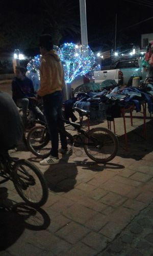 Illuminated Night People Full Length Real People Young Adult Outdoors People Photography Realpeople Peoplephotography Real Life Photography Bycicles Bycicle Bycicle Rider