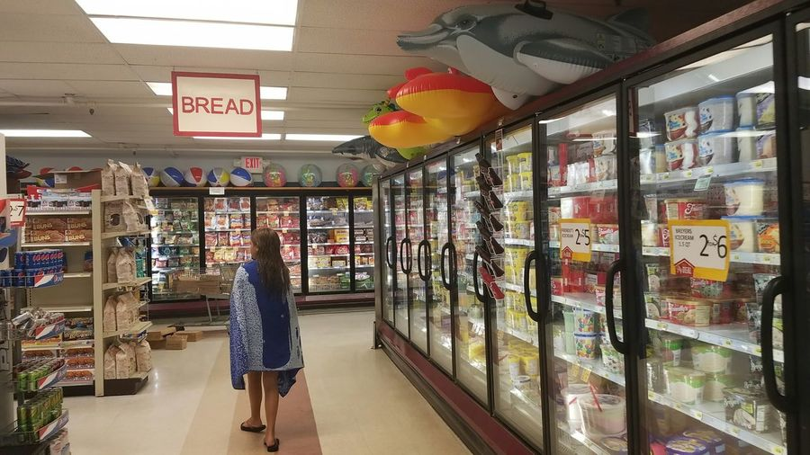 Freezer Details Shark Dragon Dolphin Choice Choices Shopping Food Distance Beach Beach Balls Rafts Inflatables Bread Towel Grocery Store Grocery Products SC Hilton Head Island, SC Hilton Head Refrigerator Looking Searching Store People Supermarket One Person