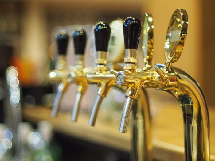 Row of beer taps at bar