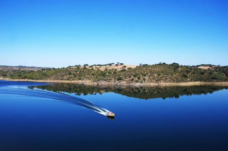 blue alqueva lake, Portugal Alqueva Lake Blue Blue Alqueva Blue Alqueva Lake, Portugal Clear Sky Lake Nature Nautical Vessel Reflection Scenics - Nature Sky Transportation Tree Water Waterfront