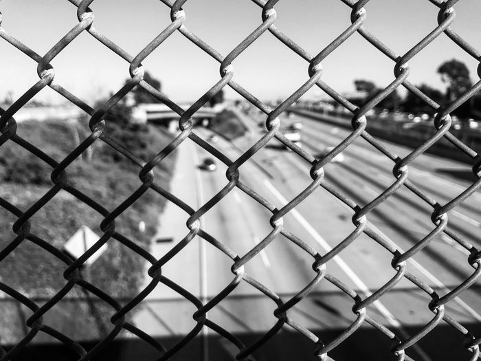 Chainlink Fence Fence Protection Safety Security Metal Focus On Foreground No People Nature Day Outdoors Close-up Blackandwhite The Street Photographer - 2017 EyeEm Awards