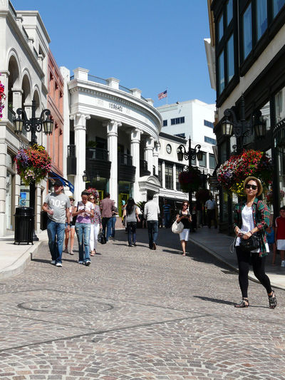 Rodeo Drive Adult Architecture Building Exterior Built Structure City Clear Sky Day Front View Large Group Of People Leisure Activity Lifestyles Men Outdoors People Performance Real People Sky Street Walking Women