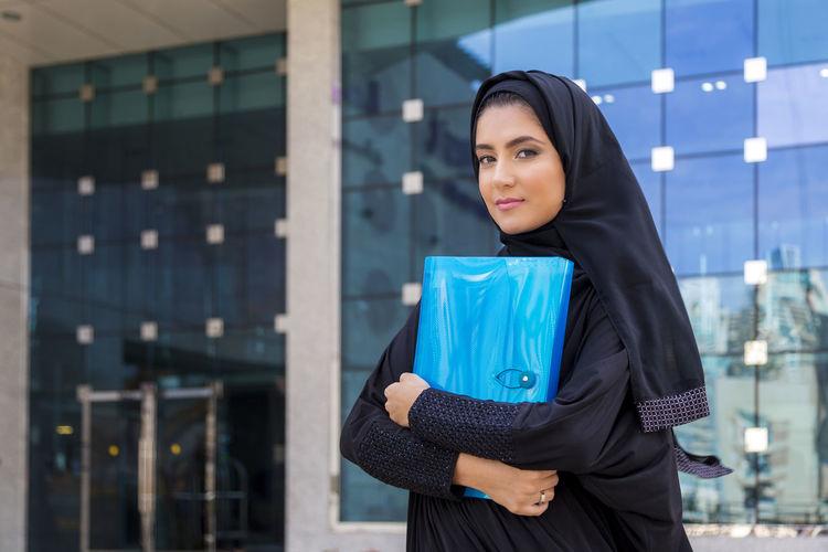Portrait of woman wearing burka in city